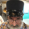 Eliot's title these days is Distinguished Professor of Psychological and Brain Sciences. Indiana University has run out of honors to award to him but, sadly, has not given him a fancy hat. He had to borrow this one.  <br /> <br /> 2017 has been a sabbatical year for Eliot - a full year on half-pay - so  we've done more traveling than we usually do because he hasn't had classes to tend. The sabbatical has given him time to hand off his journal editorship, work on a couple of substantial projects, and spend time with colleagues at the University of California at Santa Barbara and at the University of Wisconsin. <br /> <br /> 2018 promises four - FOUR! - graduate students finishing their theses; the appropriate hat for next year's work might be a miner's helmet with attached light.