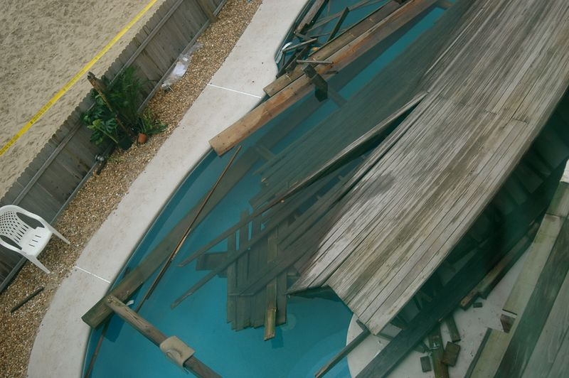 Less than 18 hours after the collapse. View from 3rd Floor- Down to snd Floor remaining Deck and into the Pool.