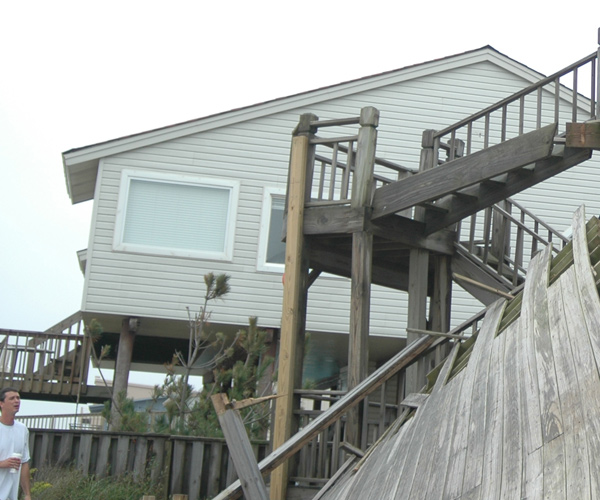 View from North end, to stairs and remaining portion of second level deck, with newer added 2 by ? along stair.