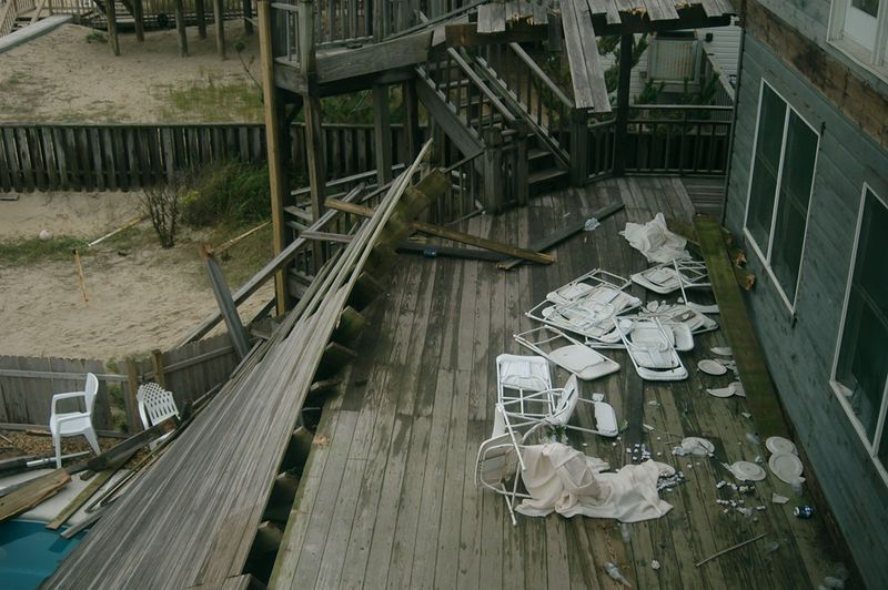 View through third floor window, to remaining portion of second level deck, with debris. Third level deck has collapsed outer 8 ft. section of second level deck.