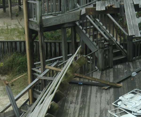View from North end, third floor window, to stairs and remaining portion of second level deck, with newer added 2 by ? along stair.