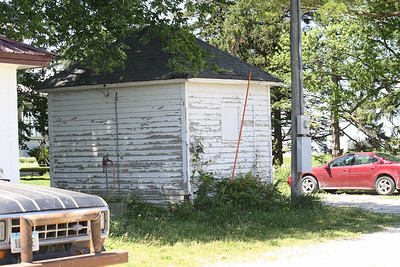 This tiny building has been neglected for many years.  We'll be restoring it this fall.  Since our barn is no longer Red.  We'll honor the Cream House by going barn red with bright white trim.