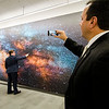 Gardner Mayor Mark Hawke snaps a photo while State Rep. Jon Zlotnik checks out a mural tour the new Dr. Daniel M. Asquino Science Center at Mount Wachusett Community College on Tuesday afternoon. SENTINEL & ENTERPRISE / Ashley Green