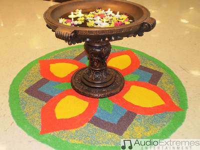 The design on floor is colored rice designed by Harleen & Surpreet