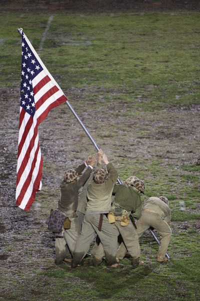 During halftime, the United States Marines reenacted the Raising of the Flag on Iwo Jima.  It depicts five United States Marines and a U.S. Navy corpsman raising the flag of the United States atop Mount Suribachi during the Battle of Iwo Jima in World War II.