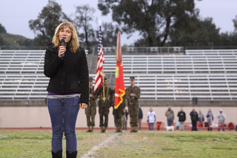 The singing of our National Anthem.