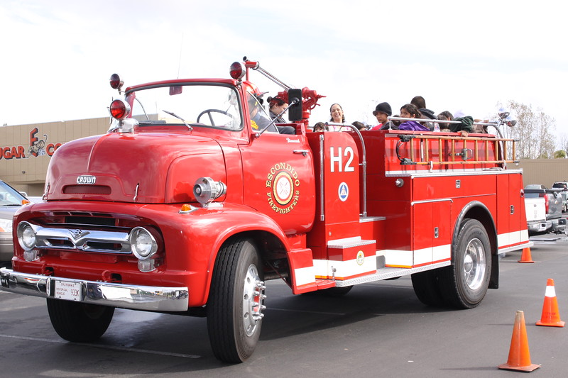 Mike O'Conner, Director of the Terry Farrell Firefighters Fund of California, drove this vintage 1964 fire truck while families enjoyed riding in the back.