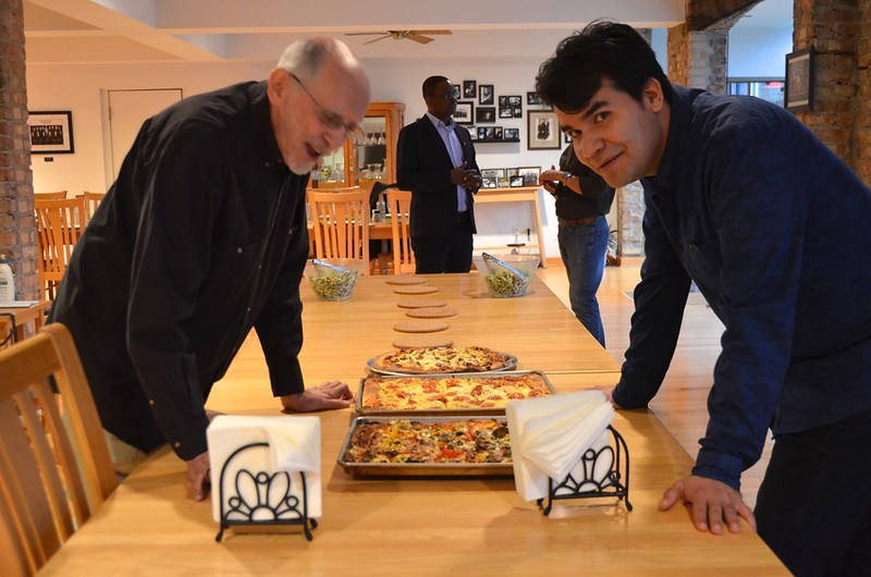 Fr. Bob and Angel eye up the pizzas