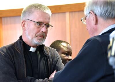 Fr. Stefan Tertünte speaking with Fr. John van den Hengel on the break