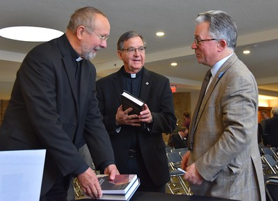 Fr. Byron and Fr. Mark get their books signed by the author