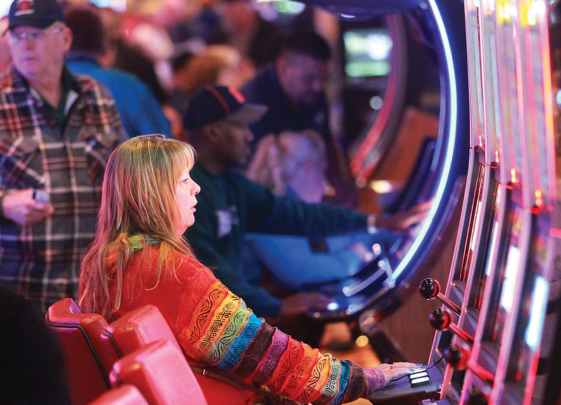 Spencer Tulis/Finger Lakes Times<br /> linda Johnson of Moravia tries her luck at one of the many slot machines.