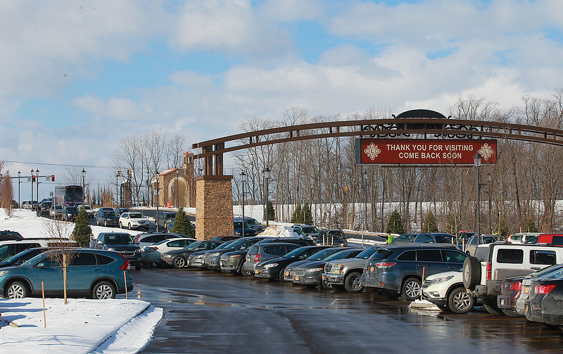 A long line of vehicles makes their way into the site an hour after doors opened for business Wednesday.