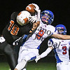 Watertown-Mayer's #9 breaks up a pass against Delano's Calvin Wishart, the state's leading reciever, in the second quarter Wednesday night in Delano. Two plays later, though, Wishart secured a catch for the Tigers' first touchdown. Delano won the game 26-6.