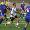Delano senior Grace Beltrand works the ball between a group of Watertown-Mayer players earrlier this season. This past Tuesday, Beltrand helped the Tigers take down Holy Family 1-0. It was Delano's first win over Holy Family.