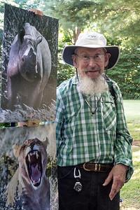 Karl showing photos_Bob Hunt
