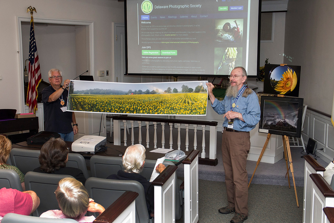 Karl Leck showing Panoramic photo  with  John Powell