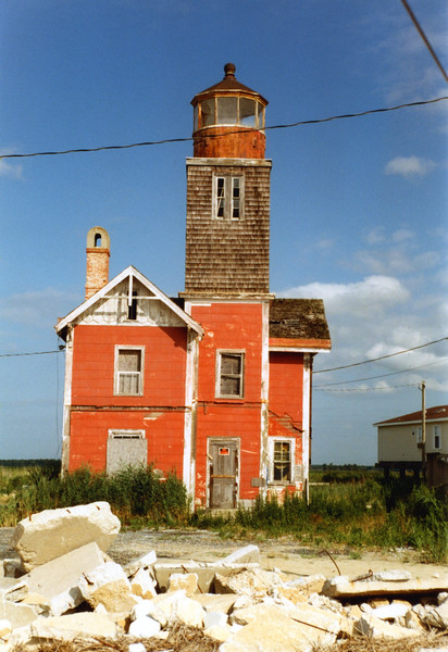 After 12 years, Congress appropriated $5,000 to re-establish a light station at Mispillion. The new lighthouse was completed in 1873. It was a buff colored 65 ft square wood tower displaying a light from a Sixth Order Fresnel lens. The tower rose from the second story of a Gothic style wood keeper's house. This is the light shown in these pictures.
