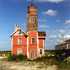 In 1932 the lighthouse was sold at public auction. After years of neglect the lighthouse began to deteriorate. In 2001 a group called the Keepers of Mispillion Lighthouse was formed to care for the light. A lawyer had promised to purchase the light for the group, but troubles arose in the negotiations. In the meantime fate intervened when lightning struck the tower and a fire destroyed the tower and gutted the house. The lighthouse was lost, or so it seemed. The burned remains of the light were secretly purchased by John and Sally Freeman who owned a building lot in Lewes' Shipcarpenter Square, a neighborhood reserved for residences consisting of relocated historic structures. In 2005 they completed rebuilding the lighthouse using parts from the old building, proving the adage you can't keep a good lighthouse down!