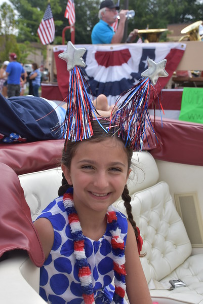 People from all over lined the streets in Marple Newtown to see the grand parade which included community floats, bands, antique cars and lots of candy.