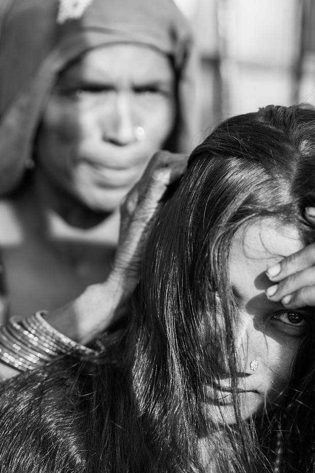 Woman having her hair groomed, Meena Bazaar