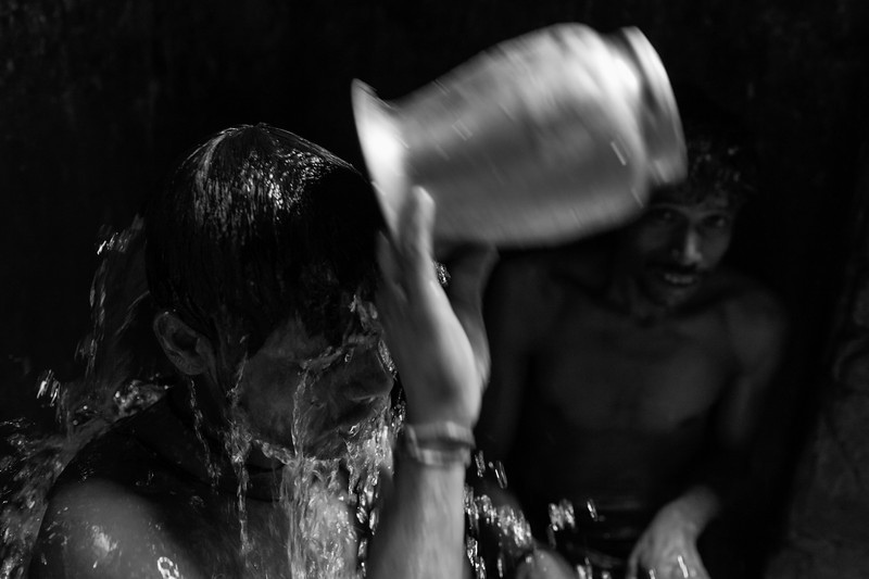 Man washing after work in the coal market