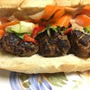 """Banh Mi"" Meatball Sub with pork meatballs, pickled vegetables, Fresno chile, and fresh cilantro"