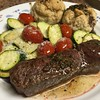 Seared Flat Iron Steak with Garlic-Chive Butter with buttermilk biscuits and pecorino zucchini