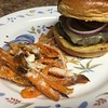 Umami Burger with Miso-Marinated Beef with mushrooms, white cheddar, and Parmesan sweet potato fries