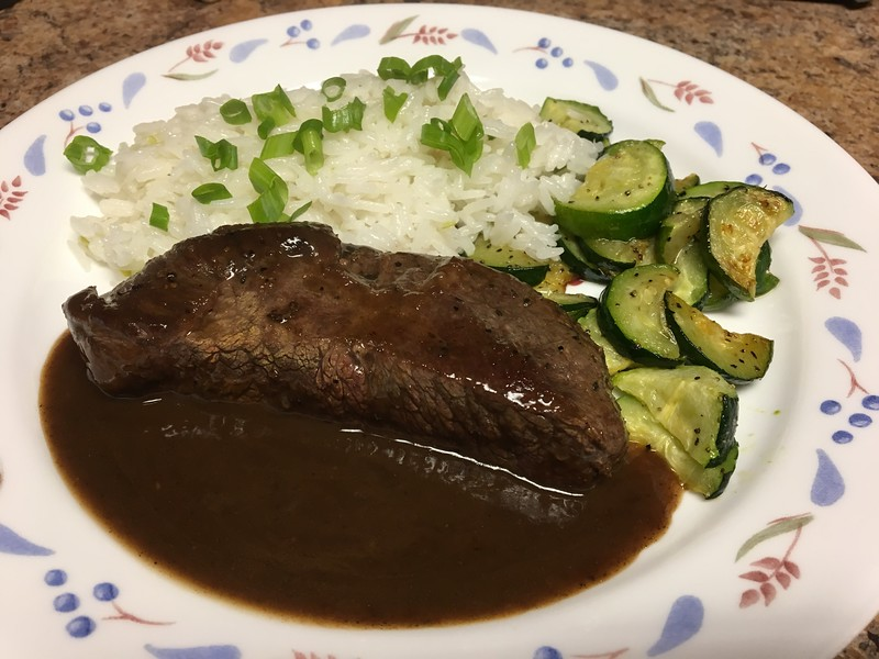Caribbean Jerk Steak with roasted zucchini and coconut rice