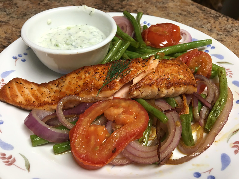 Grilled Salmon with Lemon-Dill Yogurt Sauce with green beans, tomatoes, and cucumber