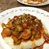 Spicy Cajun Shrimp and White Cheddar Grits  with roasted peppers and mushrooms