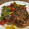 Hot Honey Pork Chop  with roasted snow pea-shallot medley