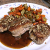 Brown Sugar and Pecan-Crusted Pork Tenderloin Medallions with sunchokes and carrots