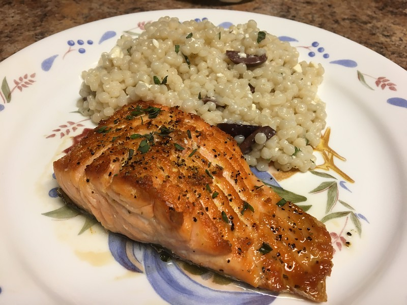 Lemon-Pepper Steelhead Trout with couscous, feta, and Kalamata olives