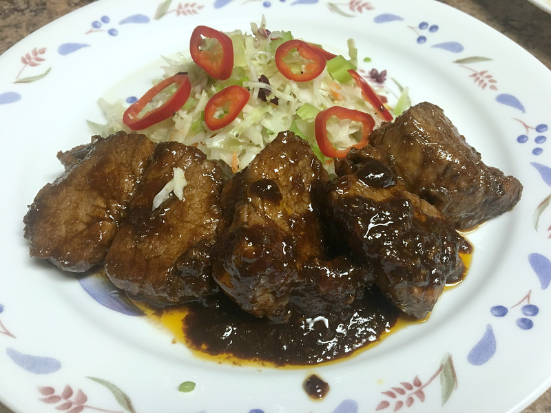 Korean Pork Medallions with crunchy rice vinegar slaw, Sriracha marinade, and red chiles