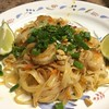 Shrimp Pad Thai with carrots, roasted peanuts, and cilantro