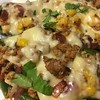 Turkey-Stuffed Poblano Peppers with red enchilada sauce, Chihuahua cheese, and corn