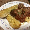 Spaghetti and Ricotta Meatballs with pecorino garlic bread
