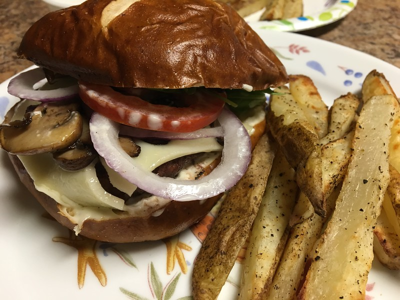 Mushroom and Swiss Beef Burger with Prezel Bun truffle mayo and steak fries