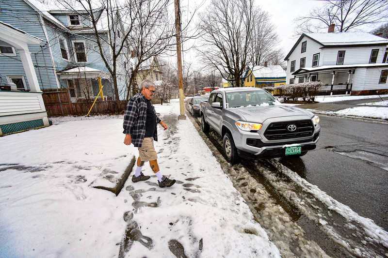 KRISTOPHER RADDER — BRATTLEBORO REFORMER<br /> Gino Butler delivers meals on Frost Street, in Brattleboro, Vt., as the Brattleboro Senior Center adjusts its meals program amid the COVID-19 outbreak. Residents now leave baskets outside their doors for the food delivery in order to limit their contact with other people during the virus.