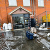 KRISTOPHER RADDER — BRATTLEBORO REFORMER<br /> Gino Butler leaves the Gibson Aiken Center with meals to deliver for the Senior Meals program as residents stay inside as part of the COVID-19 outbreak on Thursday, March 19, 2020.