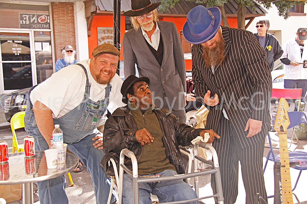 "Martin ""Big Boy"" Grant, James Lewis Carter ""T Model"" Ford, Ronald Robbins, Sean ""Bad"" Apple<br /> Rock & Blues Museum (outside)<br /> Clarksdale MS 2012"