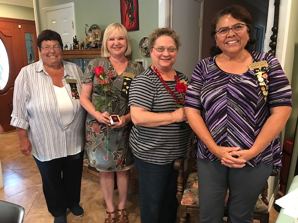 Members President Suzanne Fraser and Angela Loya, 2nd Vice President honor members for service to chapter.
