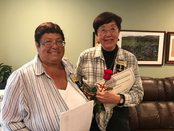 Member Dr. Sumie Imada honored by Pres. Suzanne Fraser for community service.