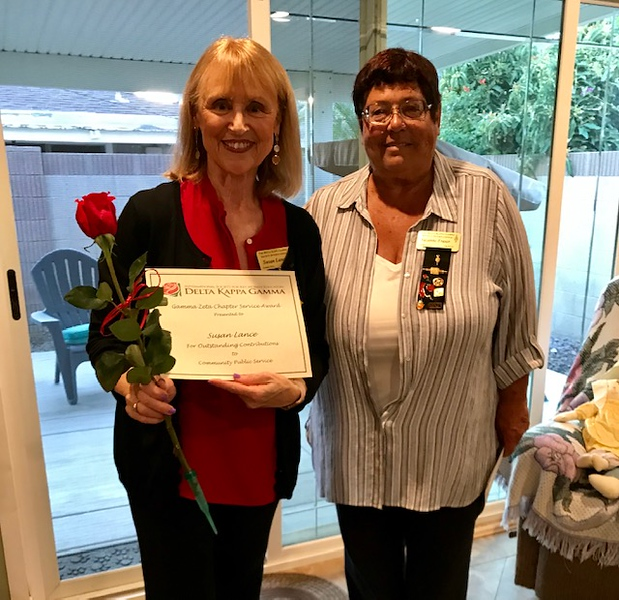 Member Susan Lance is honored for community service by President Suzanne Fraser.