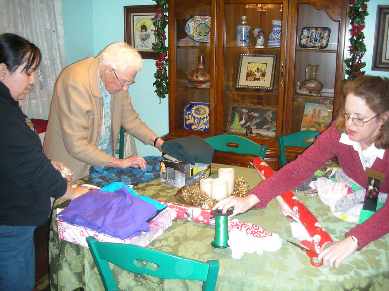 Mary Lash and Karen Bowen wrapping gifts