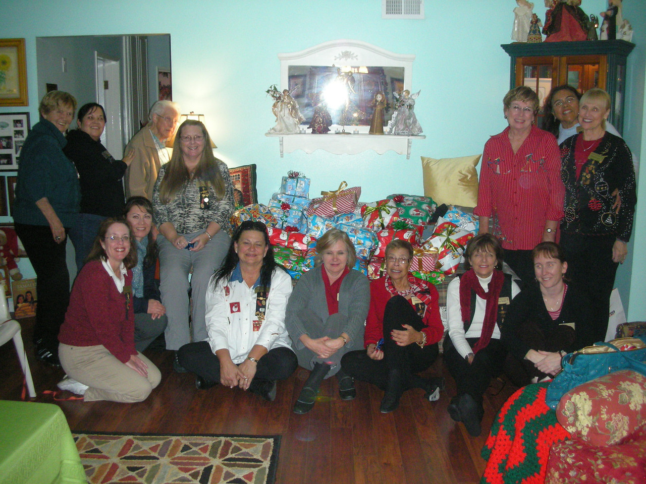 Gamma Zeta Chapter and Alpha Chi Chapter wrapping gifts for the Rio Hondo Temporary Shelter Xmas 2010 at Angela Loya's home.