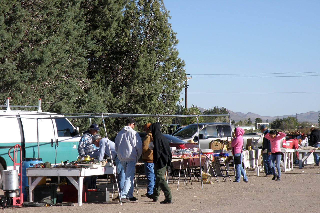 Rows of Vendors and Shoppers in a relaxed country flea market !