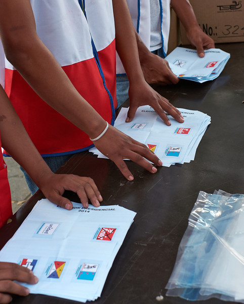 Election day in Santa Ana: <br /> Vigilantes from each of the three major parties keep their stack of votes which then are carefully counted in front of everyone.