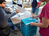 Election day in Santa Ana: <br /> A voter places her ballot in the carefully sealed box.